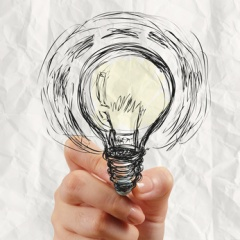 hand drawing light bulb with crumpled paper